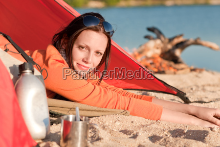 camping happy woman in tent by