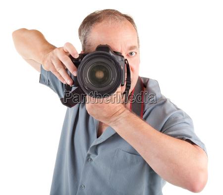 male photographer shooting you