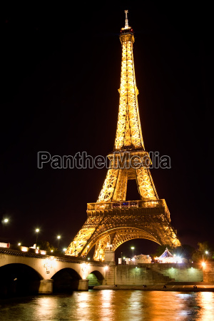 eiffel tower illuminated at night