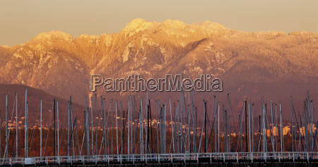 vancouver though sailboat masts golden snow