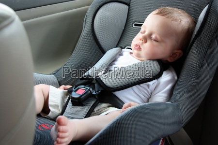 beautiful baby sleeping in car seat