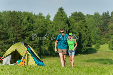 young camping couple hugging in summer