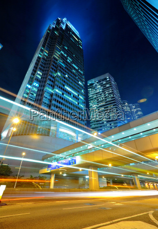 light trails on the modern building