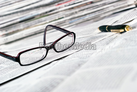 reading glasses and pen