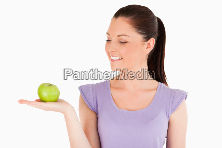 good looking woman holding an apple