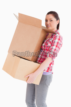 good looking woman holding cardboard boxes