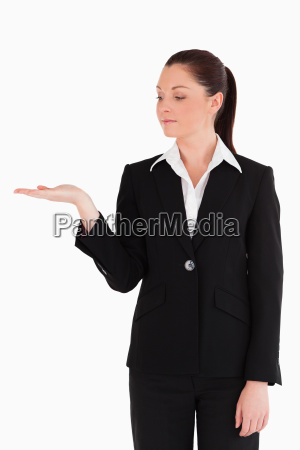good looking woman in suit showing
