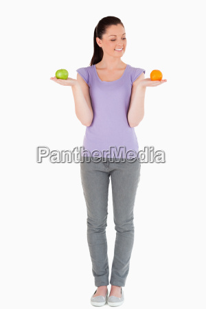good, looking, woman, holding, fruits, while - 5141441