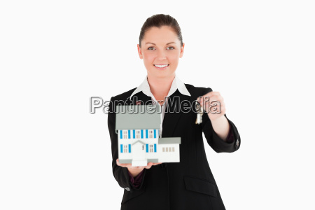 good looking woman in suit holding