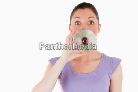 good looking woman hiding her mouth
