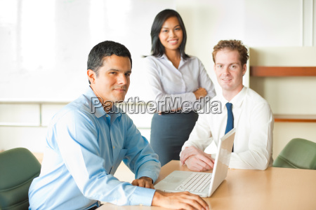 latino male meeting leader diverse team