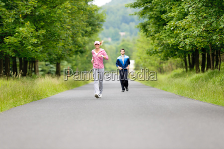 jogging sportive young couple running park
