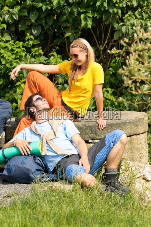 hiking young couple backpack relax sunny