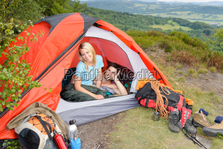 camping young couple sunset tent climbing