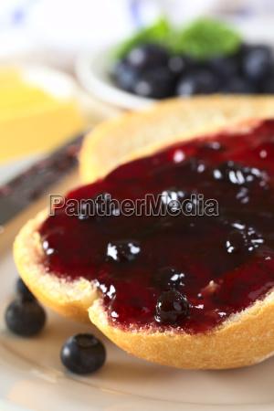 blueberry jam on half a bun