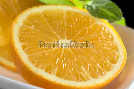 orange slices with mint leaf