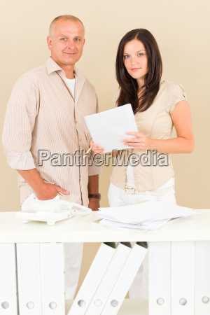 casual businesswoman and businessman standing