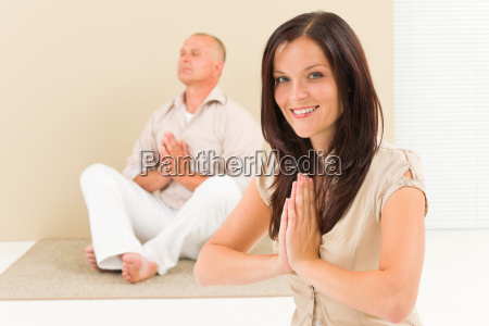 casual business yoga woman meditating colleague
