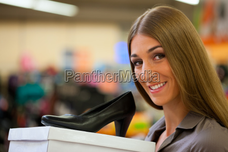 woman, buying, shoes, in, a, store - 5188875