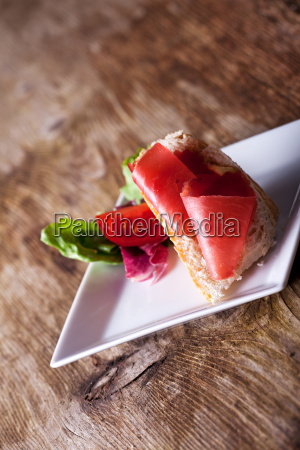 close up of a ham sandwich
