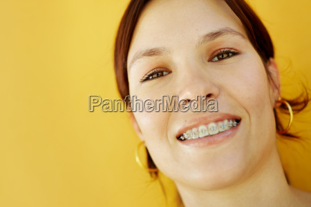 young college student smiling at camera