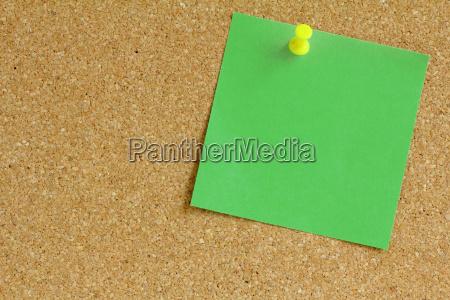 notepad on cork bulletin board