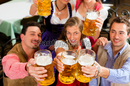 people drinking beer in bavaria
