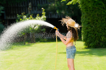 summer garden woman play with water