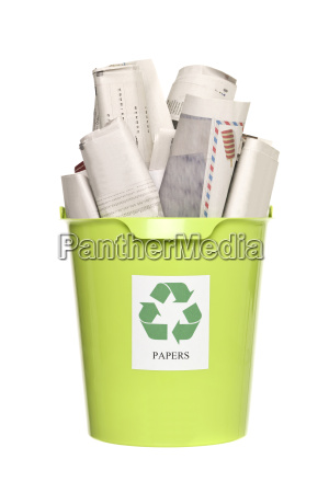 recycling bin with newspapers