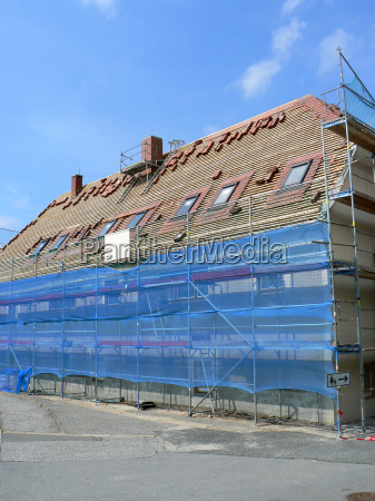 construction site with blue safety scaffold