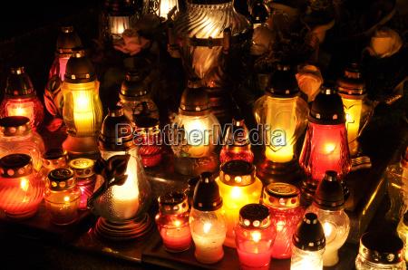 candle flames illuminatingduring the night of