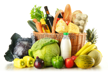 groceries in wicker basket isolated on