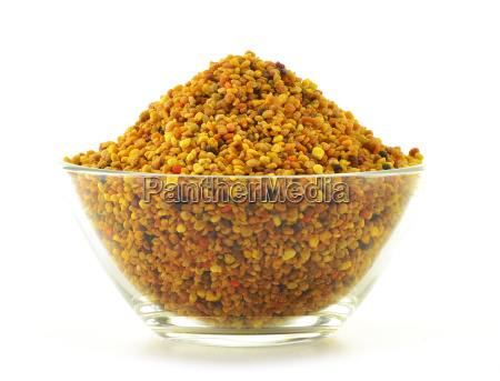 bowl with bee pollen isolated on