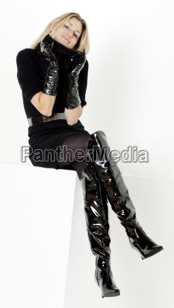sitting woman wearing black dress and