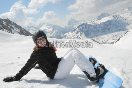 laughing young woman with snowboard in