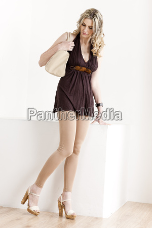 standing woman wearing summer clothes and