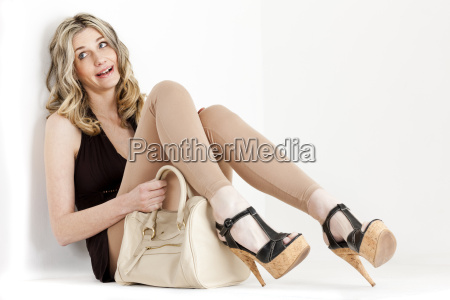sitting woman wearing summer clothes and