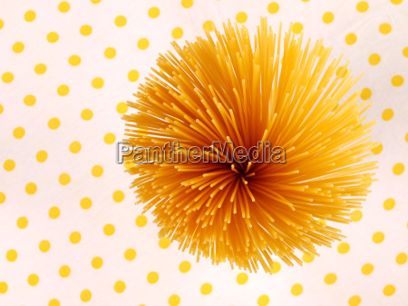 pasta background with spaghetti and dots