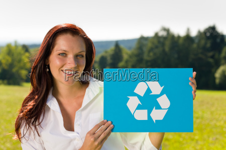 recycling sign young businesswoman sunny