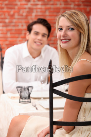 man and woman dining at a