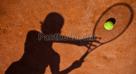 shadow of a tennis player in