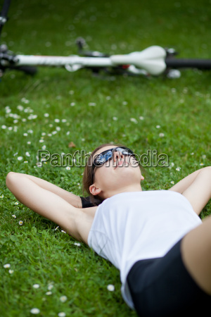 pretty female biker relaxinghaving a rest