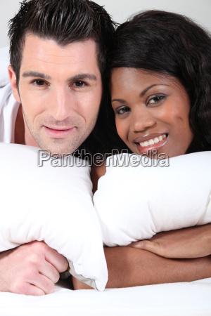 young man and young woman smiling