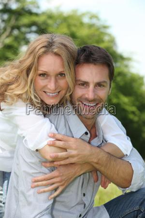 happy couple sat outdoors
