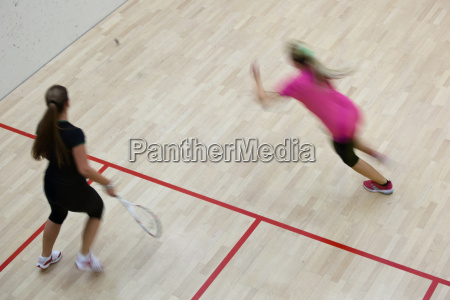 two female squash players in fast