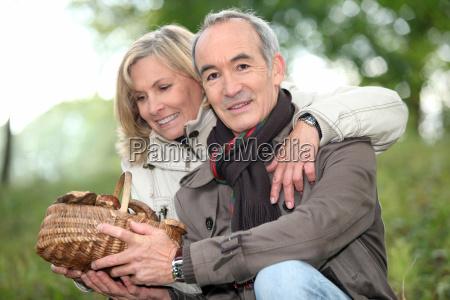 couple picking mushrooms