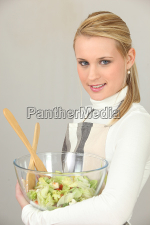 woman carrying bowl of salad on