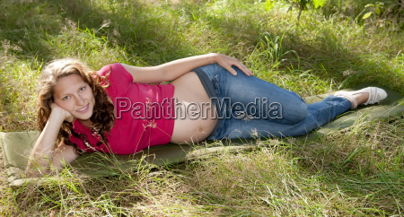 pregnant young woman is lying in