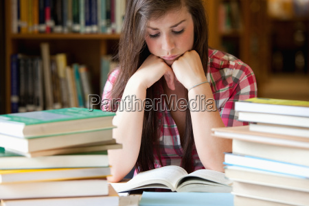 studious, woman, surrounded, by, books - 5454278