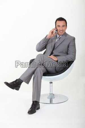 executive in a swivel chair talking
